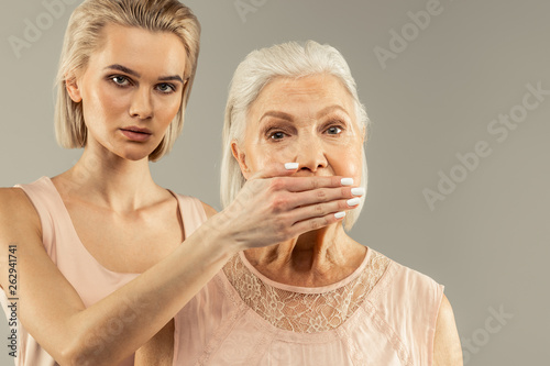 canvas print picture Nice aged woman having her mouth covered