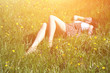 Cute girl lies on the grass on a sunny summer day