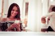 Joyful brunette female person reading income message