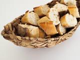 italian bread slices on a braided basked
