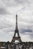 Eiffel Tower view in Paris, France with cloud sky