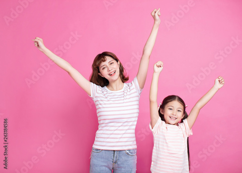 Happy mother and child celebrating success - 263184586