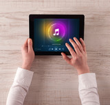 Hand touching tablet with music play  concept