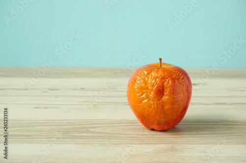 canvas print picture Rotten apple on the table. テーブルの上の腐ったリンゴ
