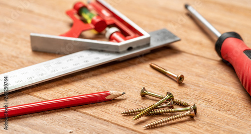 Woodworking tools on a wooden background - 263250764