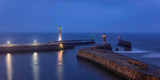 Whitby Harbor. Lighthouses on the East and West Piers. North Yorkshire. North Sea. England.  Long exposure.  Main focus on piers