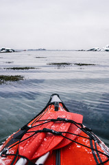 Winter Kayaking Along Coast of Lofoten Archipelago in the Arctic Circle in Norway