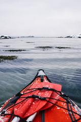 Winter Kayaking Along Coast of Lofoten Archipelago in the Arctic Circle in Norway