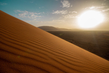 Sunset over desert dune