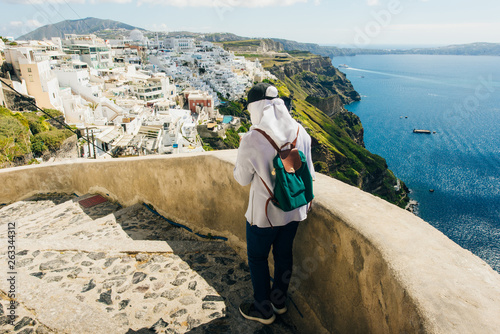 tourist girl in the city of Fira on the island of Santorini in Greece
