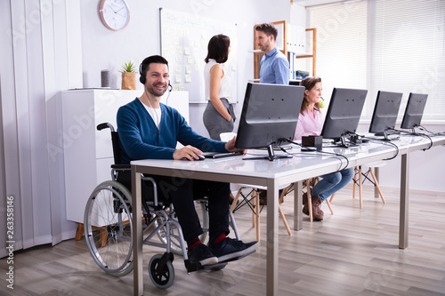Handicapped Man Working On Computer © Andrey Popov