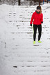 canvas print picture - Woman wearing sportswear exercising during winter