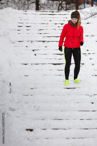 Woman wearing sportswear exercising during winter © Voyagerix