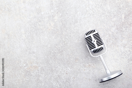 Vintage microphone on grey background