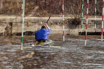 kayaking slalom water training. woman with a paddle in a kayak