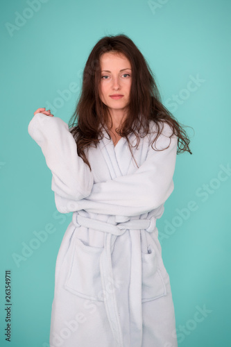 canvas print picture Spa and wellness concept. Girl no makeup face long hair wear bathrobe turquoise background. Ready for spa procedures. Woman relaxed after massage session or spa. Beauty salon. Spa and skin care