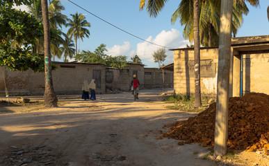 Local children go to school. Morning in an african village. Zanzibar, Tanzania, Africa