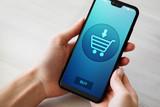 Fototapeta Kawa jest smaczna - Ecommerce Online shopping on mobile phone screen. © WrightStudio