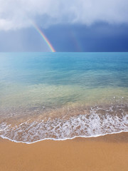 Rainbow over the sea beach © Edi