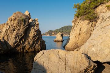 Costa Brava seascape. Spain coast. Rocks and cliffs in sea beach in Lloret de Mar in the morning