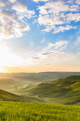 Sunrise in the rolling hills with mist in the valley © Lars Johansson