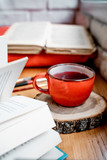 cup of tea and book on wooden table