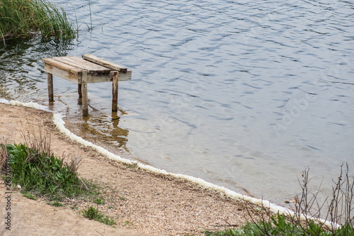 jetty of a calm lake of salt water © Alberto