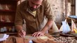 Talented joiner creates the sails for a wooden boat