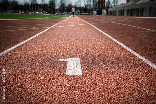 All-weather running track with highlighted number one, first place and way to goal concept