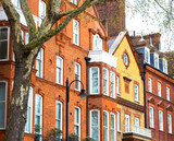 Luxury brick house with white windows in quiet area in central London. Apartments on the banks of the Thames.