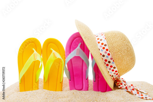 sandals and hat in the sand of the beach