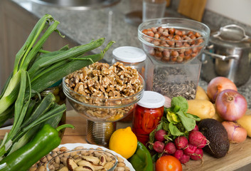Vegetables and nuts on kitchen tabletop