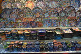 plates, bowls and crockery in the Spice Souq in Dubai, colorful retail display, shop setting
