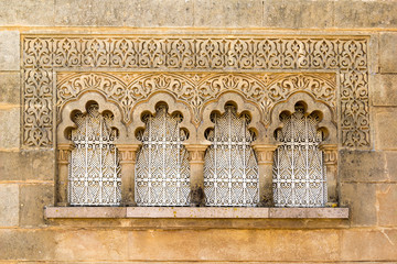 Traditional Moroccan window in moorish style of architecture and ornament on stone wall