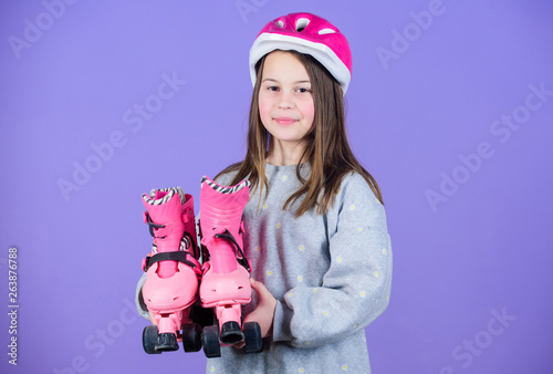 Happy child with roller skates  race workout of teen girl  Roller