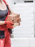 Woman working with bricks