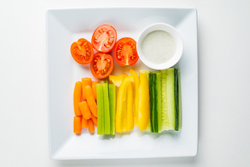 fresh organic vegetables with dip on the white background