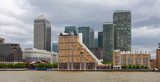 Canary Wharf skyline on River Thames waterfront, London, England
