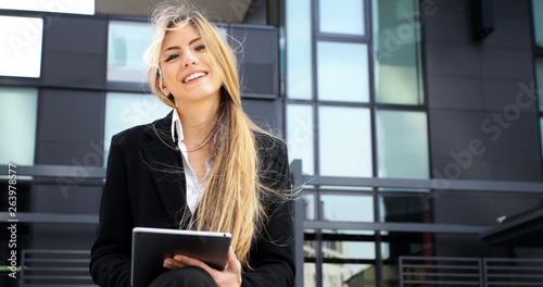 Smiling businesswoman using a digital tablet outdoor © Minerva Studio