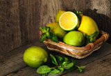 limes and lemons on wooden table