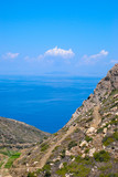 greek landscape in naxos with meadow, mountain and blue sky.