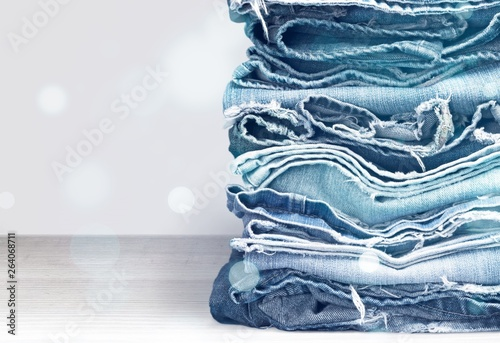 Stack of jeans clothes on background © BillionPhotos.com