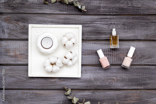 modern design of work desk with nail polish and perfume on wooden background top view © 9dreamstudio