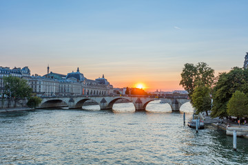 Sunset view of Seine river in Paris, France. Architecture and landmarks of Paris. Postcard of Paris