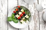 Vegetarian vegetable shashlik made of cherry tomatoes, mozzarella and black olives.