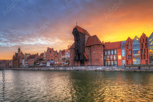 Old town of Gdansk with historic Port crane over Motlawa river at sunset, Poland. © Patryk Kosmider