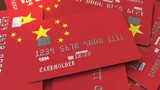 Pile of credit cards with flag of China. Chinese banking system conceptual 3D animation