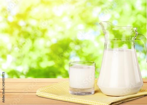 Glass of milk and jar on table © BillionPhotos.com