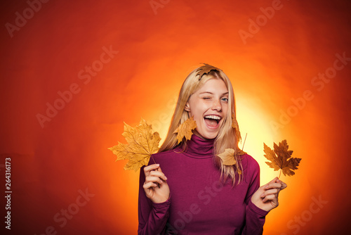 Beautiful sensual blonde playing with leaves. Autumn woman holding gold leaf. Autumn discounts on lingerie. Cloud rain umbrella. Raining concept. Sale of womens panties. Autumn concept.
