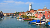 The Island of San Pietro with its curious leaning  Tower and view of Arsenale wall , Venice.